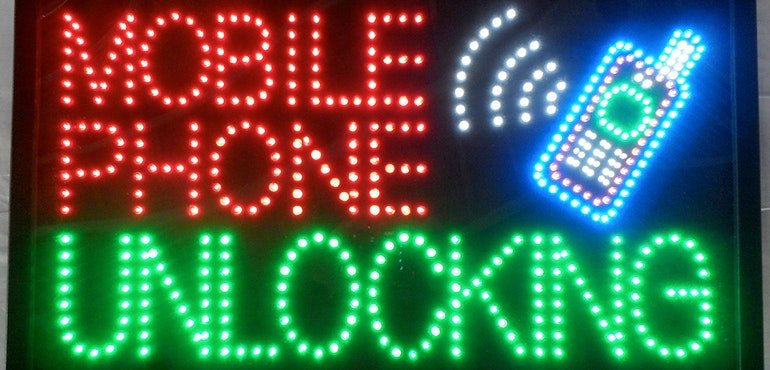 Mobile phone unlocking shop sign.